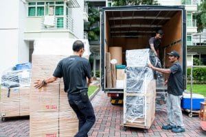 Carefully moving wrapped items into truck