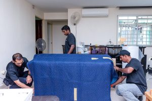 Professional and dedicated crew prepping customer's furniture before move