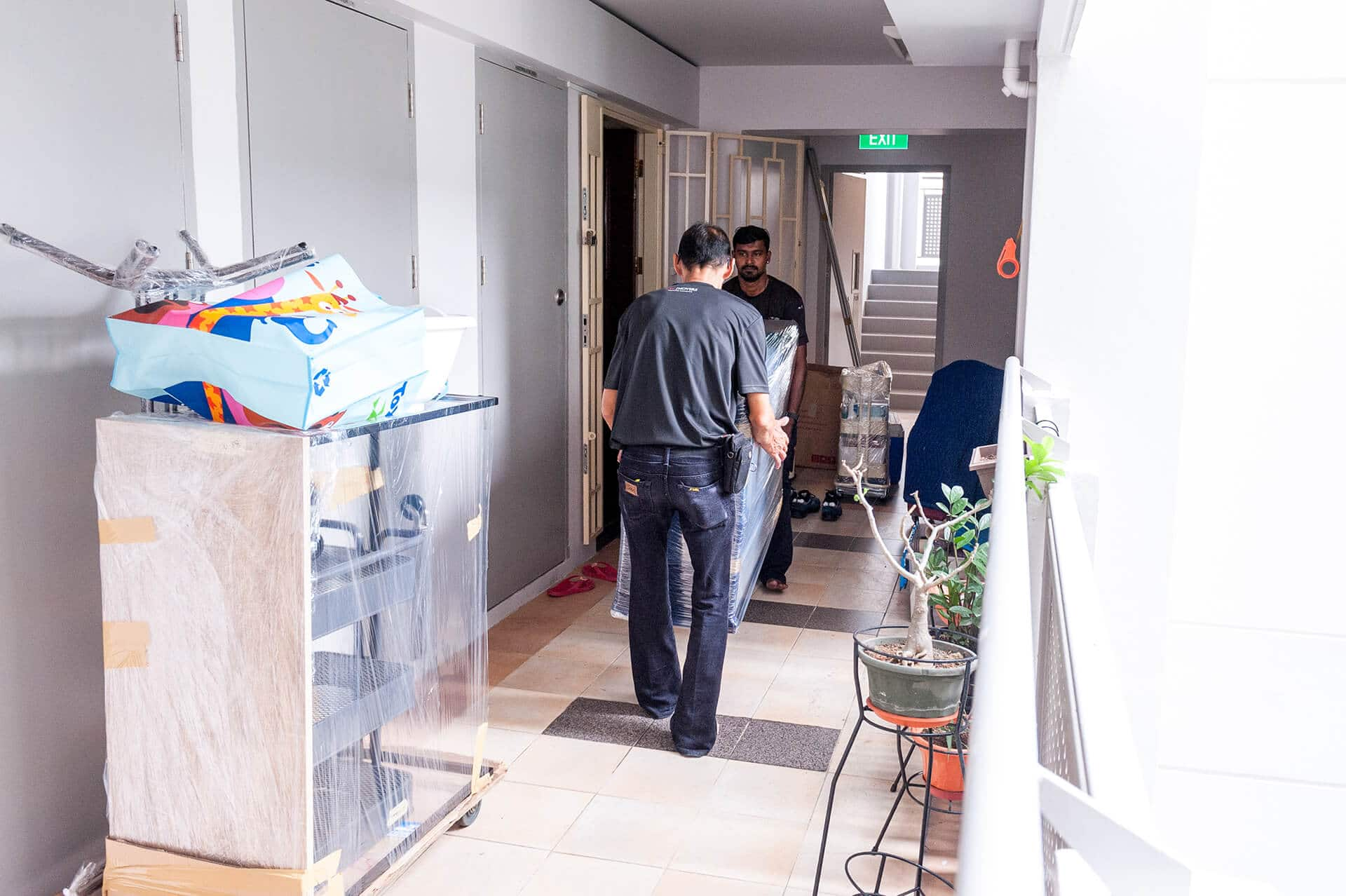 CYC Crew Carrying Furniture Along Corridors of HDB