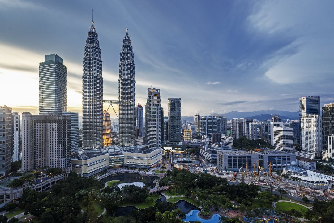 Petronas Towers Kuala Lumpur Skyline at Dusk. View you will enjoy when you move from singapore to malaysia