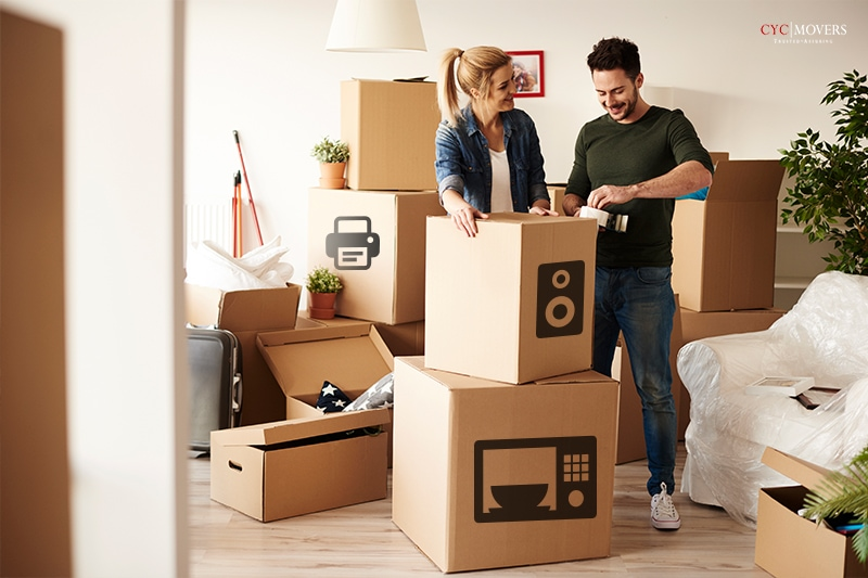 professional movers packing appliances