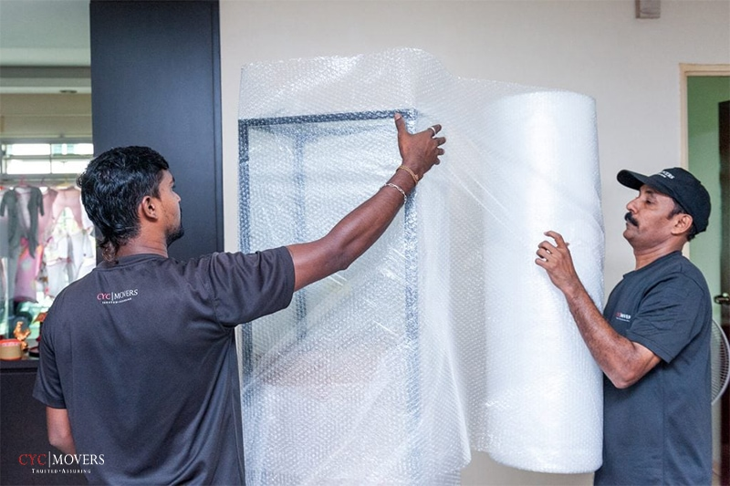 two professional movers working